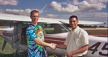 Private flight instruction ends with a handshake after the student pilot completes his solo flight at Chester Charter, Chester Connecticut